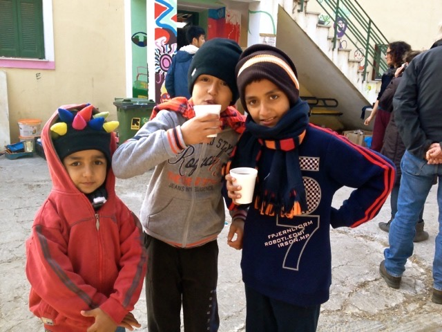 Three Syrian boys receiving welcome on the island of Lesvos in Greece in a center supported by REACT